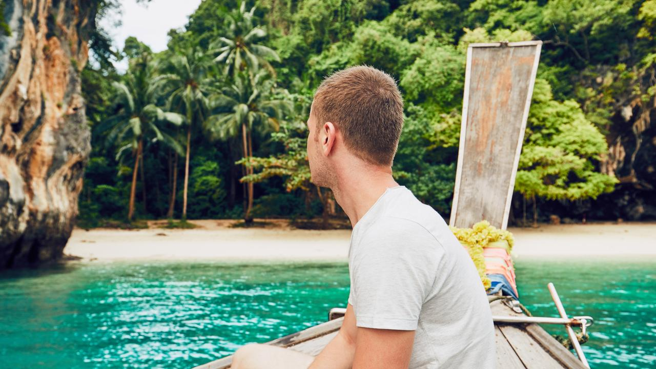 There may be more to those holiday happy snaps than meets the eye. Picture: iStock.