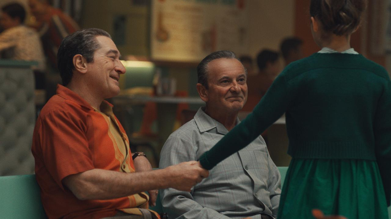 At a bowling alley, Frank Sheeran (Robert De Niro) attempts a show of warmth to his daughter Peggy (Lucy Gallina) in front of Russell Bufalino (Joe Pesci). Picture: Netflix