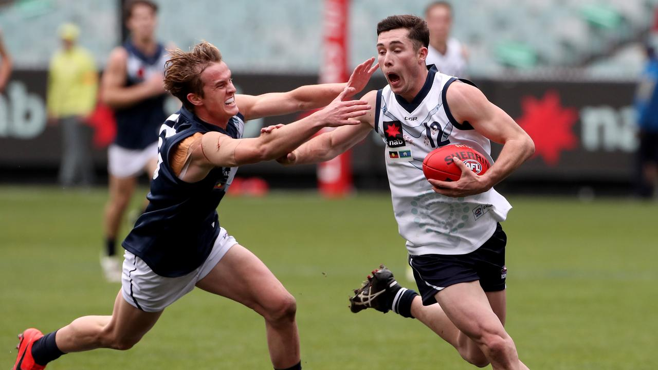 Lachlan Ash evades a tackle while playing for Vic Country.