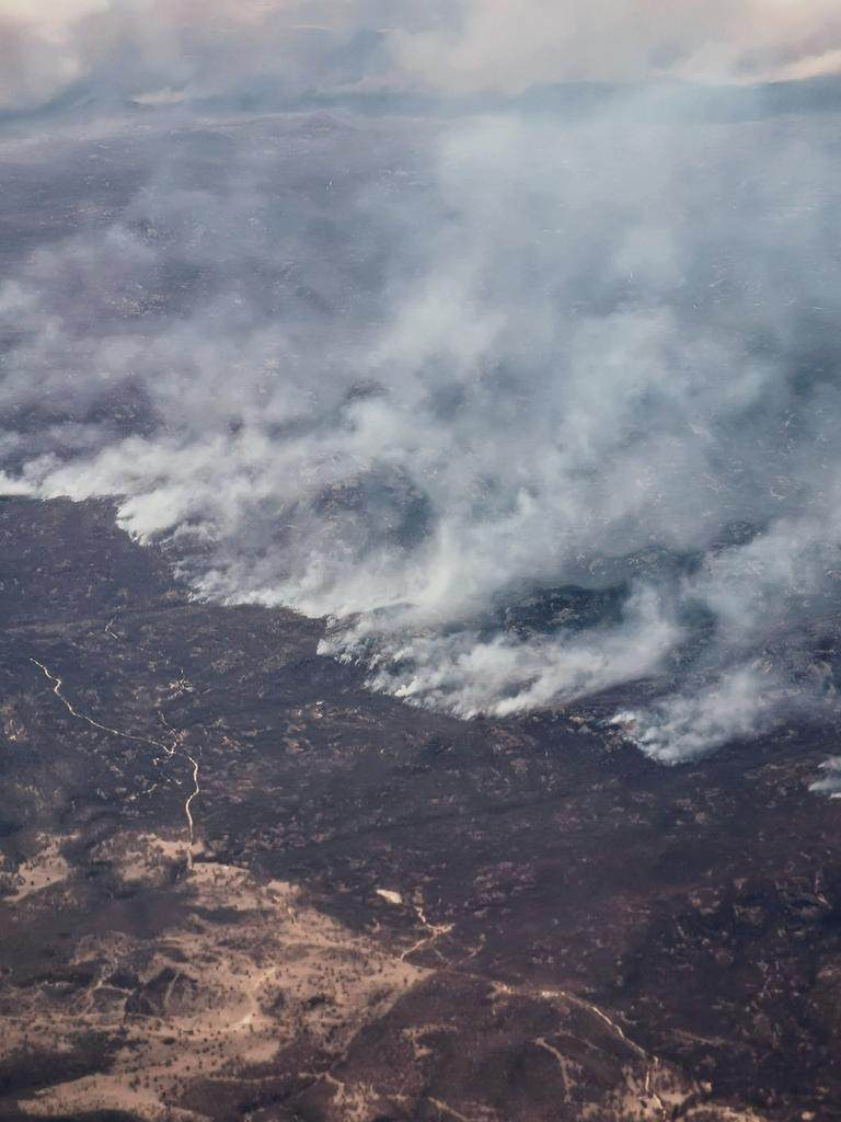 Maegan Brown took this shot of bushfire-ravaged Queensland on a flight back from Melbourne. Picture: @maegan_kb