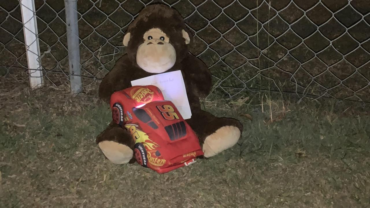 A teddy bear left by a mother and her young sons near were two baby girls were found dead in a car near Brisbane. Picture: Patrick Billings