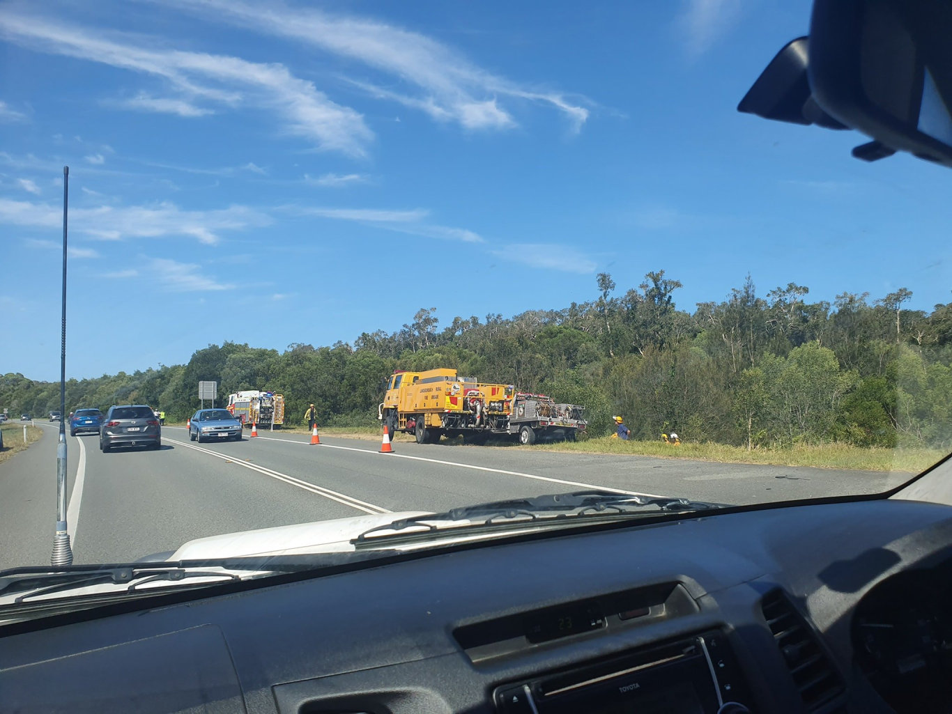 Firefighters responding to reports of a large grassfire which has broken out alongside Caloundra-Mooloolaba Road in Meridan Plains this afternoon. Photo: Bridget Ward