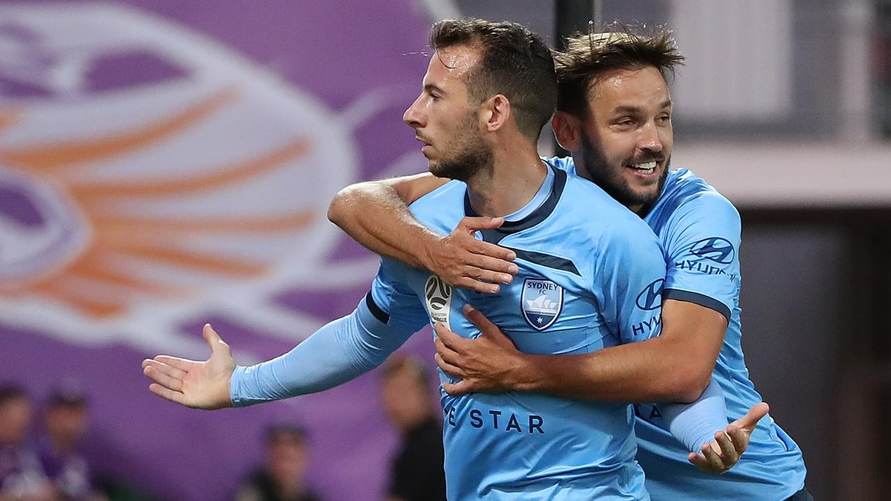 Adam Le Fondre and Milos Ninkovic of Sydney celebrate.