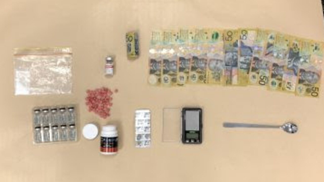 Drugs, utensils and cash recovered during a search of a Broadbeach Waters property. Picture: Queensland Police