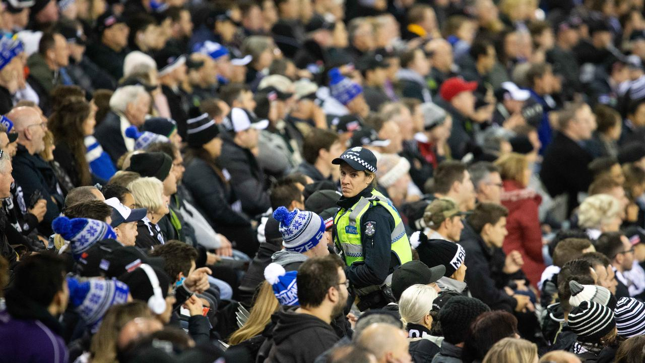 Police patrol while fans watch AFL action at Marvel Stadium. Picture: Sarah Matray