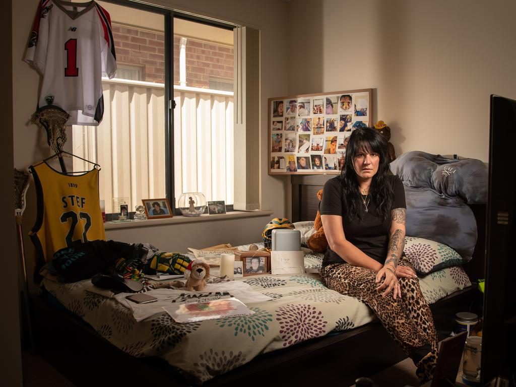 Julie Davis, the mother of Stefan Woodward in her late son's bedroom which has remained unchanged since his death in December 2015. Picture: Brad Fleet
