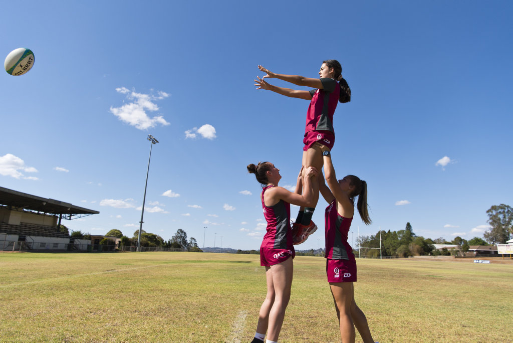 Toowoomba trio (from left) Chloe Cocks, Lily Black and Jada Ferguson have been named in the QLD Reds under-17 team that will compete at the rugby sevens national championships. Picture: Kevin Farmer