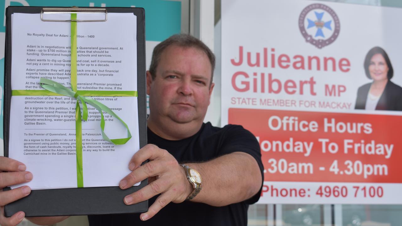 PETITION: Mackay Conservation Group spokesman Michael Kane outside Mackay MP Julieanne Gilbert's office.