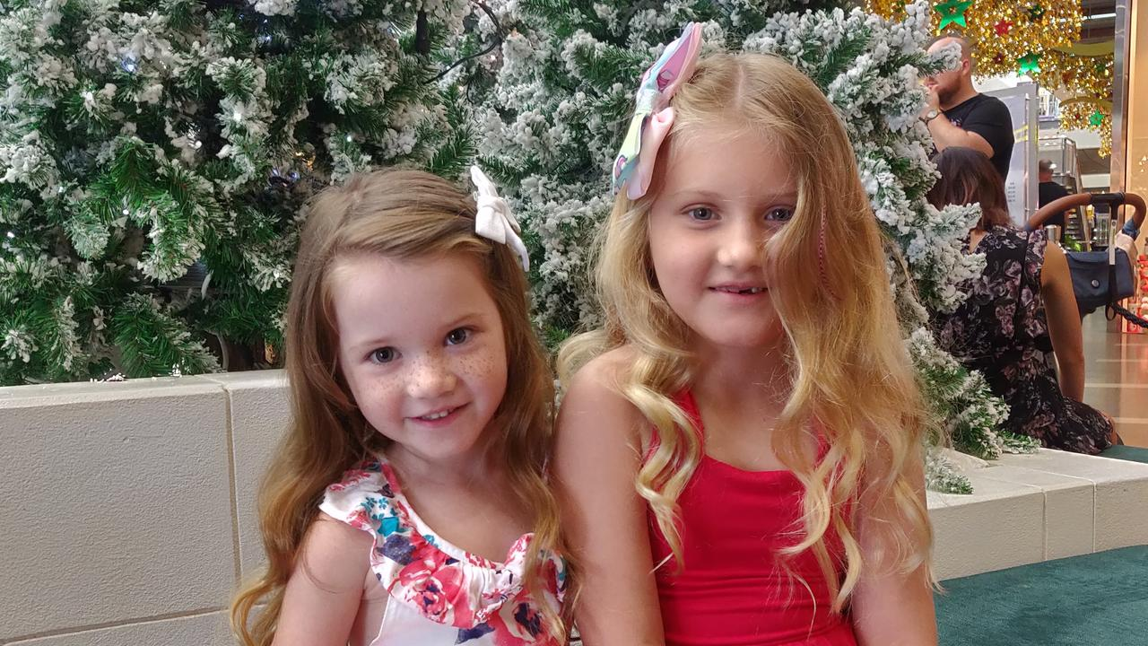 Skyla and Jayda Sterland were happy have their photo taken while waiting to see Santa. Picture: Kate Rasmussen