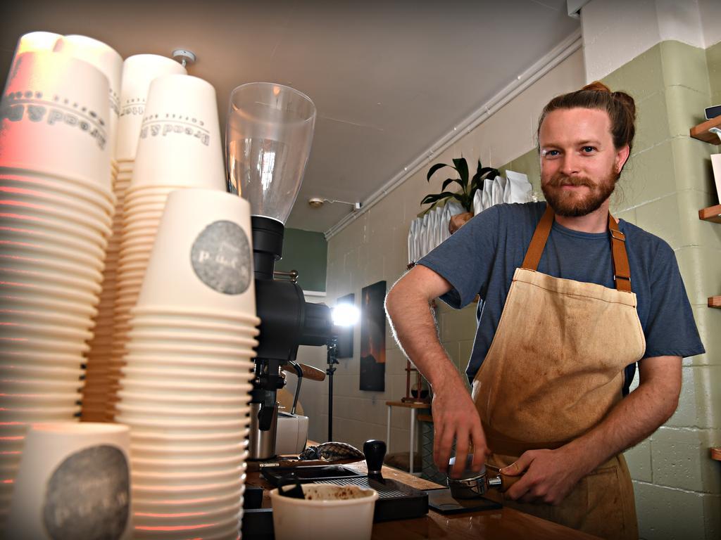 Elliot Gwynne making a coffee for a customer.