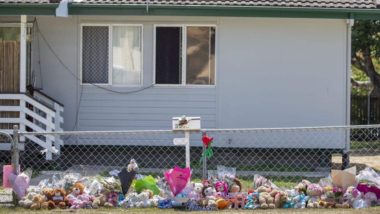 People have been laying tributes outside the house at Waterford West. Picture: AAP Image/Glenn Hunt