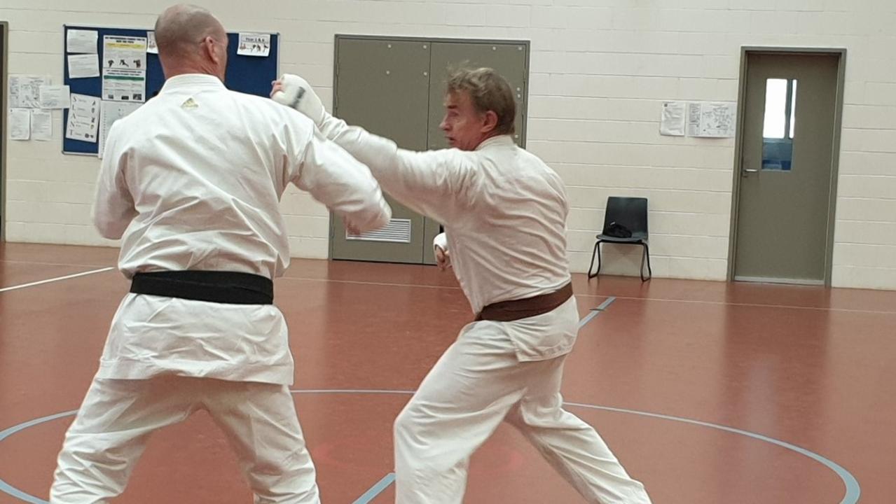 Mugen Gissen Karate Do student Owen Stewart sparring with sensei Robert Early of the Kingaroy Shotokan Club in Nanango on Saturday. (Photo: Contributed)