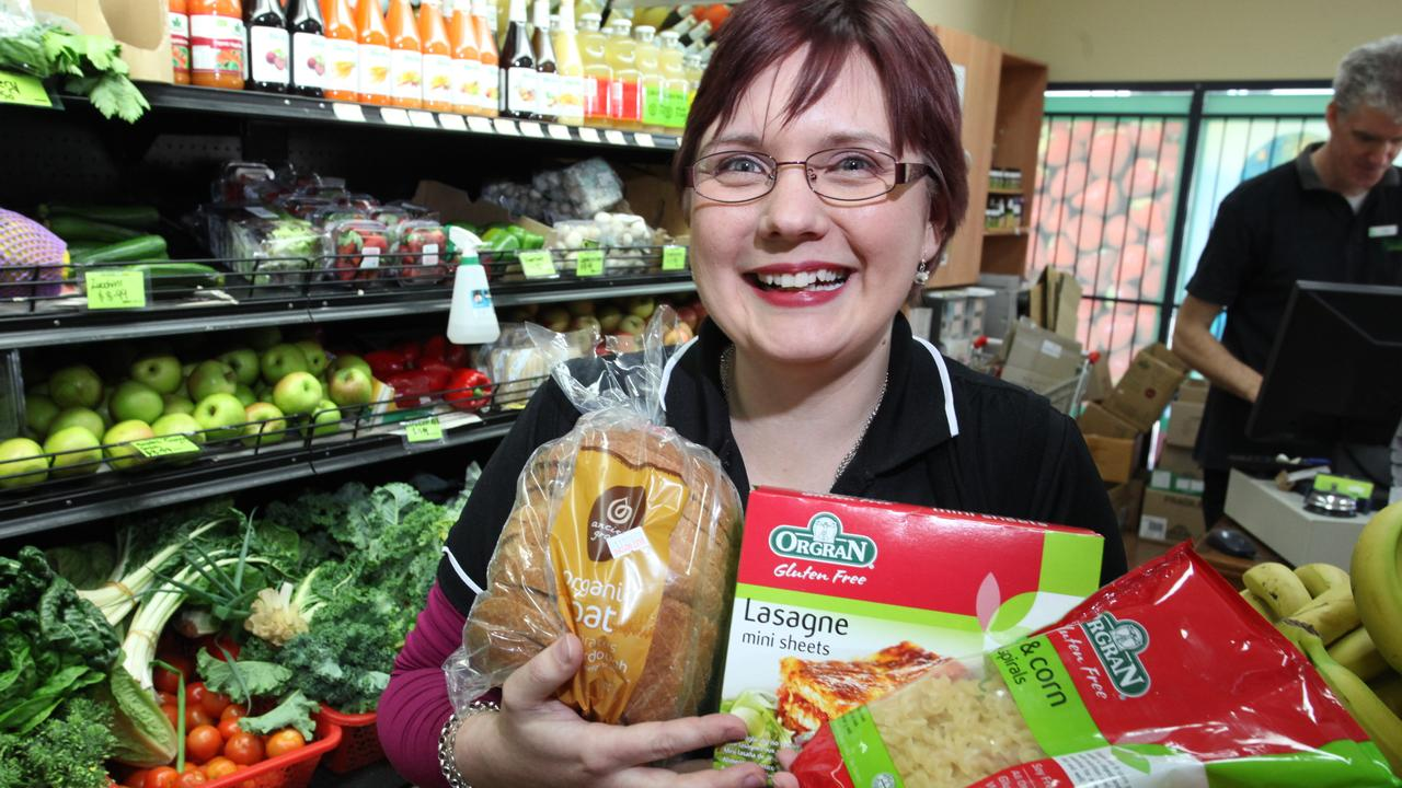 Kat Ord poses with gluten-free products at the Flannerys Chermside store. Photographer: Liam Kidston.