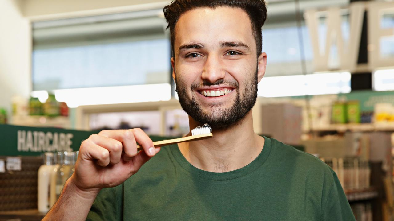 Mason Ireland, of Flannerys Mona Vale, poses with charcoal toothpaste, a new health fad at Flannerys. Picture: Adam Yip