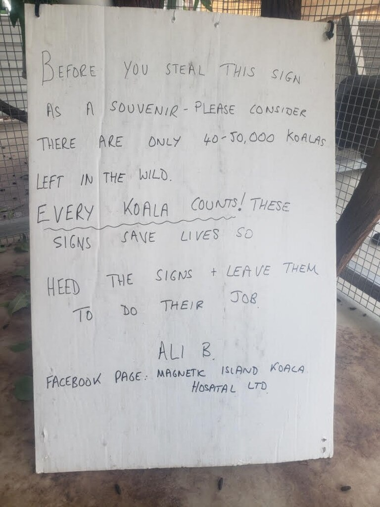 The hand-written message on the back of the Magnetic Island Koala Hospital roadside warning signs.