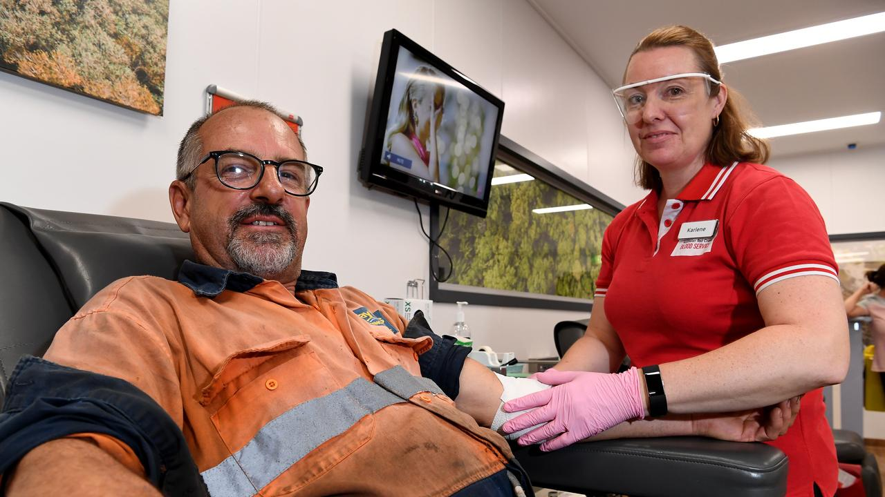 DONATING: Derek Vanderkoogh gives blood at Nambour with the help of Karlene LeCouteur Photo: Warren Lynam