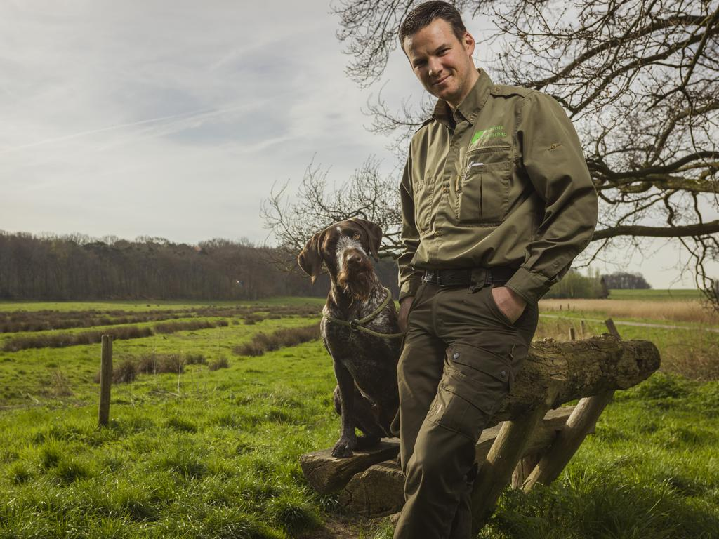 Even Brabant forest ranger Erik de Jonge's dog looks incredulous about the illegal dumping of toxic waste in the forest. Picture: Nick Franken