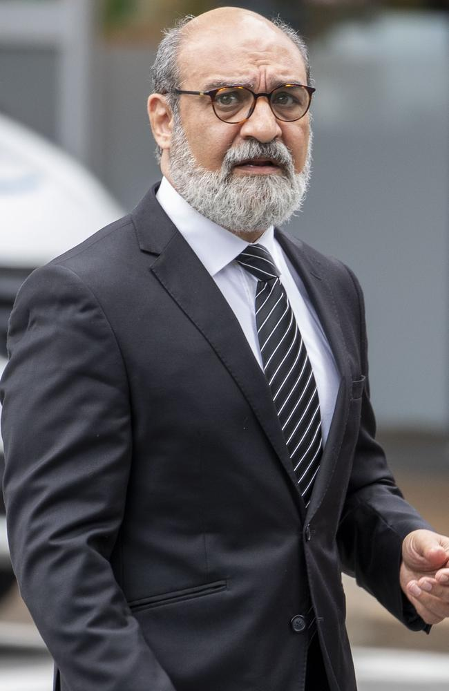 Dr Ramin Harirchian arrives at the Brisbane District Court on Monday morning. Picture: AAP/Glenn Hunt