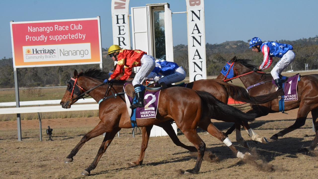 Tessa Townsend on Marlahn (red and yellow) pulls in front to win the Heritage Nanango benchmark 55 handicap 1600m race at the 2019 Nanango Spring Races.