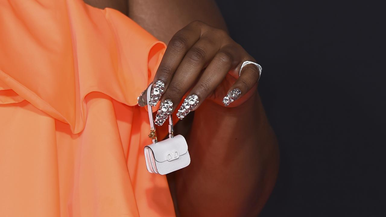 Lizzo's teeny tiny purse. Picture: Jordan Strauss/Invision/AP