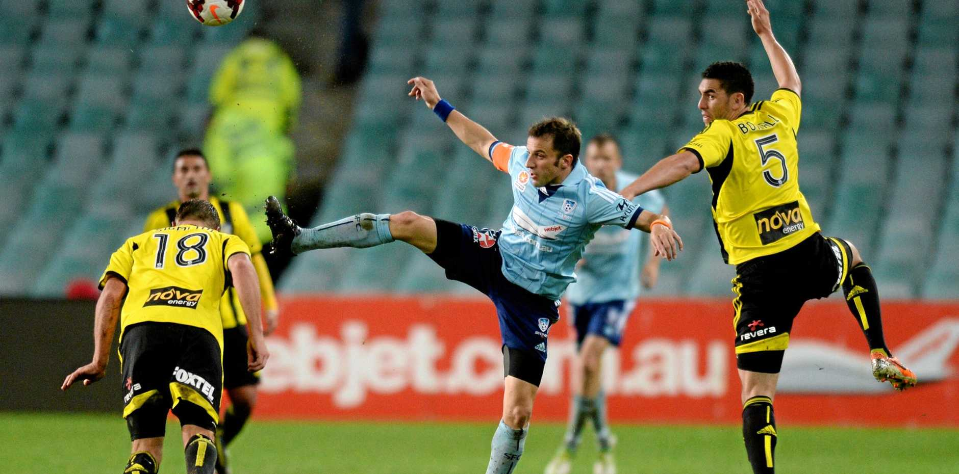Alessandro del Piero (centre) fights for the ball with Wellington Phoenix's Michael Boxall (right) in Sydney on April 6, 2014. Picture: Lukas Coch/AAP