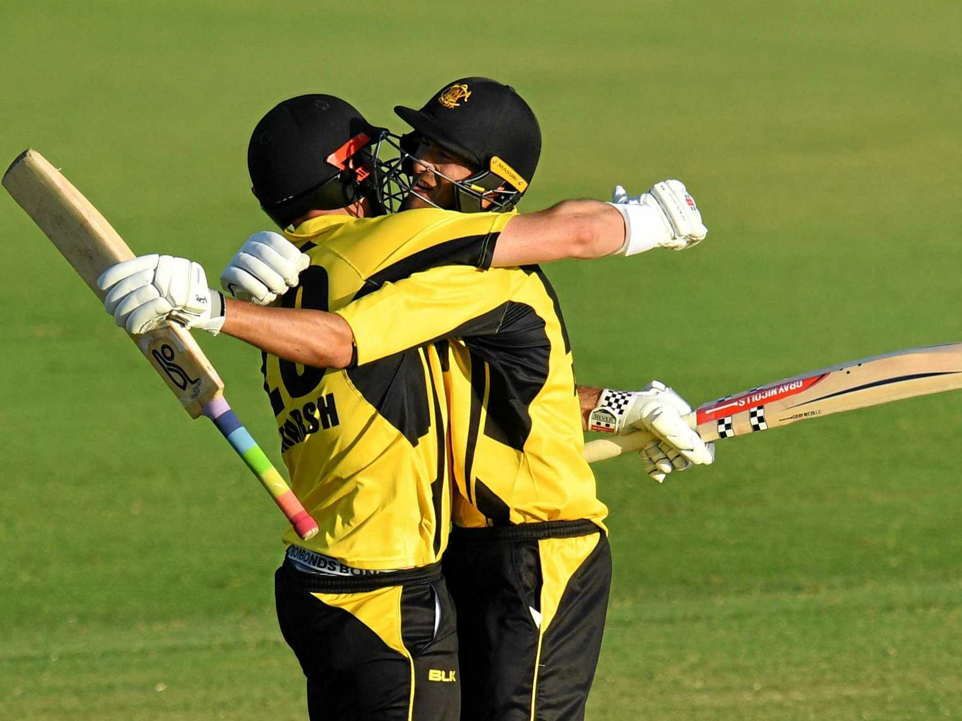 Shaun Marsh and Ashton Agar celebrate Western Australia's win over Queensland in the Marsh One-Day Cup final at Allan Border Field on Tuesday.  Picture: Darren England/AAP