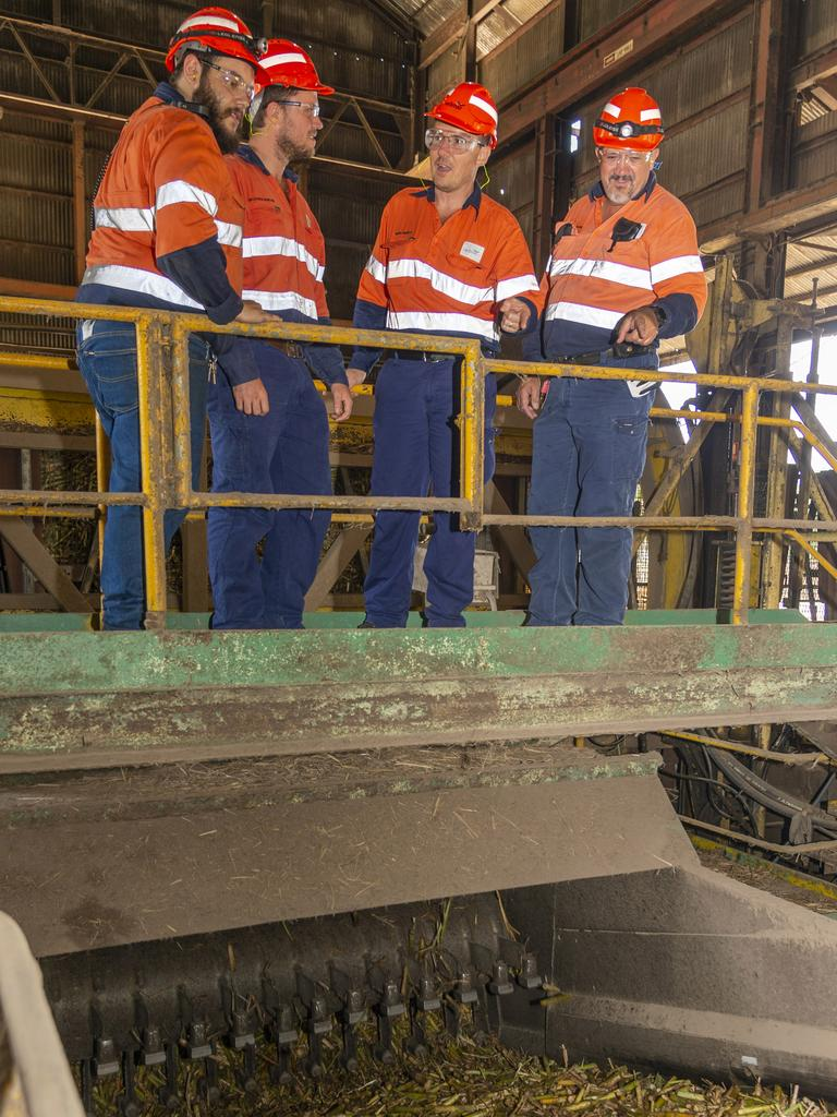 Plane Creek mill employees watch cane being processed in the final days of the 2019 crush. From left are milling train turbine operator Tristan Duffy, senior technical assistant Matt Norton, Mackay regional operations manager Craig Muddle and Plane Creek work execution superintendent Norm Van Blerk. Picture: Daryl Wright