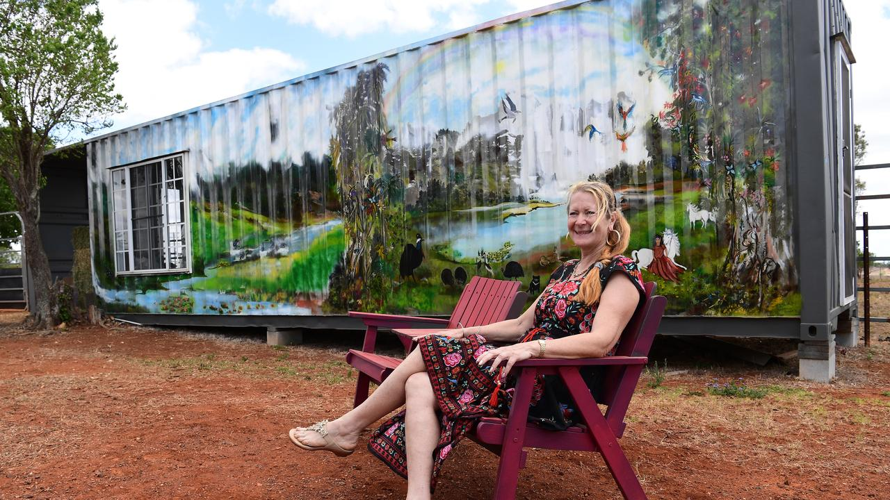 Artist Karen Stretch in front of her container mural.