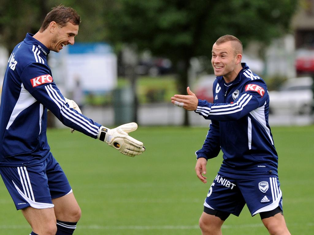 Leigh Broxham (R) sharing a laugh with Ante Covic (L) and donning a mohawk during a forgettable period in more ways than one for him and the club.