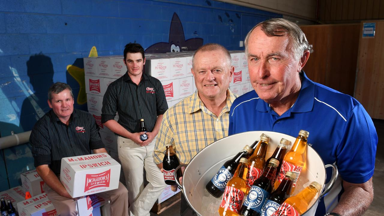 Brendan and Benjamin Cavanagh from Cook's Soft drinks, former McMahon's syrup maker Zane Sinnamon and Peter McMahon. Cartons of the soft drink are being sold to raise money for Ipswich Hospice. Photo: Rob Williams.