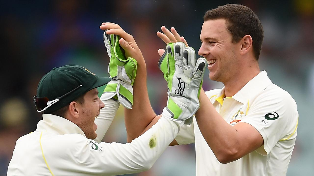 Tim Paine and Josh Hazlewood of Australia celebrate the wicket of Mohammed Shami of India during the Adelaide Test last summer. Picture: Quinn Rooney/Getty Images