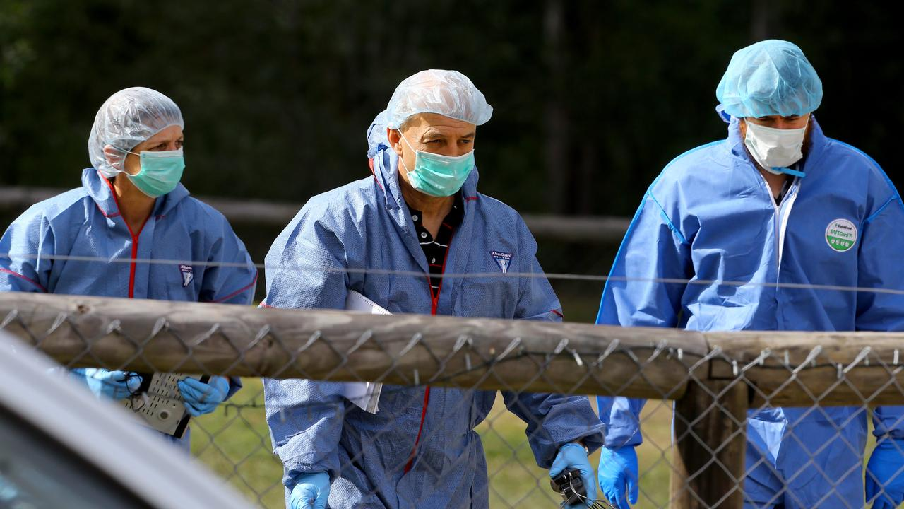 Forensic police at a property at Buccan in the wake of Larissa Beilby's death. Picture: David Clark/AAP