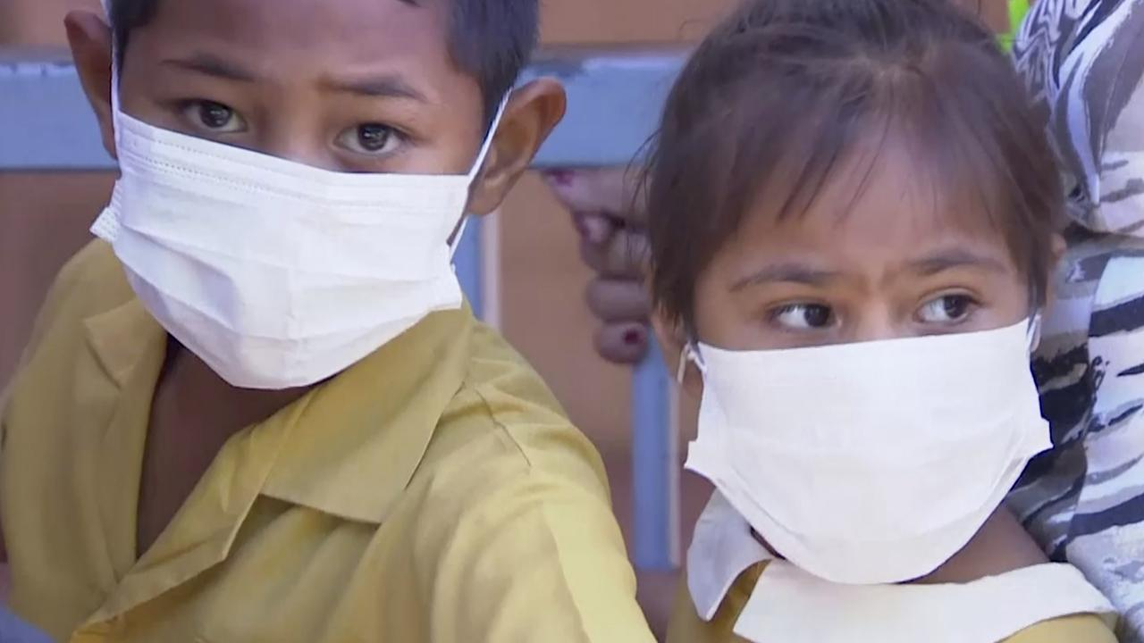 Masked children wait to get vaccinated at a health clinic in Apia, Samoa, where 24 children aged under five years have died. Picture: TVNZ