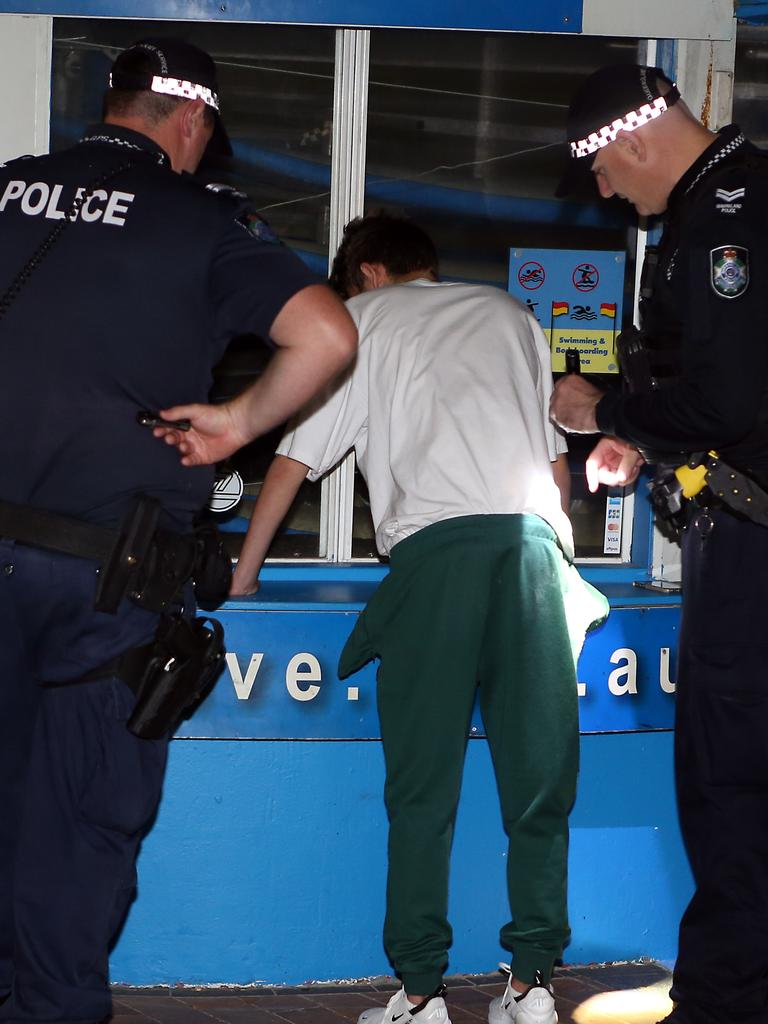 Police speaking with a Schoolie on the Gold Coast. Picture: Richard Gosling