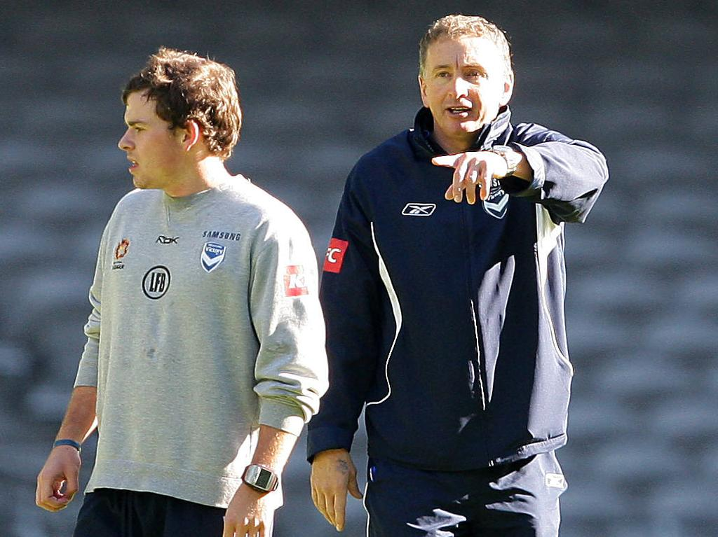Leigh Broxham (L) training, with ex Melbourne Victory coach Ernie Merrick barking instructions.
