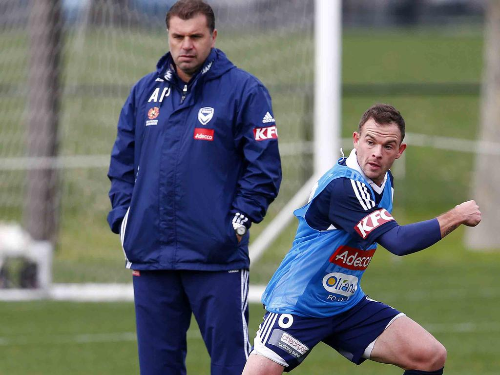Leigh Broxham under the watchful eye of Ange Postecoglou during Melbourne Victory training at Gosch's Paddock in 2013.