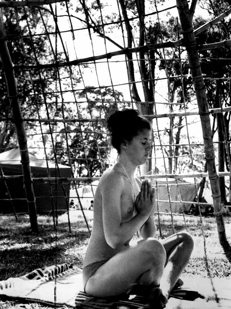 A young woman meditates topless at the Aquarius Festival at Nimbin in 1973. Picture: News Corp NSW