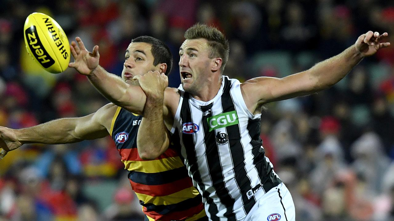 Veteran defender Lynden Dunn could be rookie-listed by Collingwood.