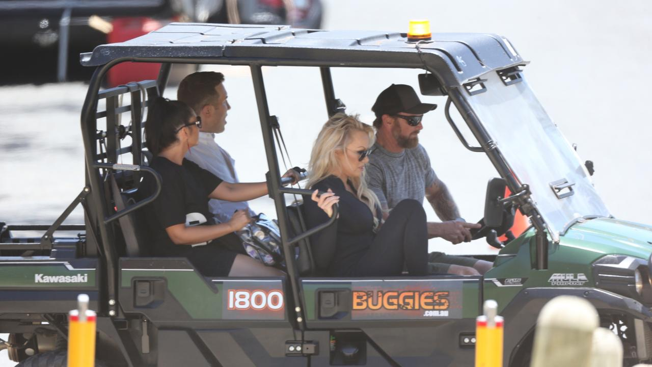 Pamela Anderson arrives on a Gold Coast beach to begin filming for Ultra Tune. Picture: Nathan Richter.