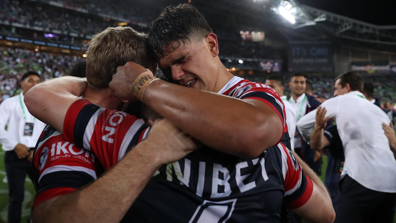 Seems like this was a farewell hug from Latrell Mitchell. Picture: Brett Costello