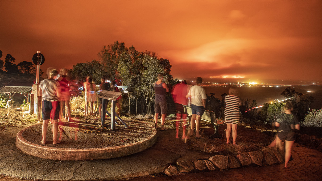 Many people came to quietly watch the sky at the Maclean Lookout as fires near Woombah and Ashby created an ominous red glow.