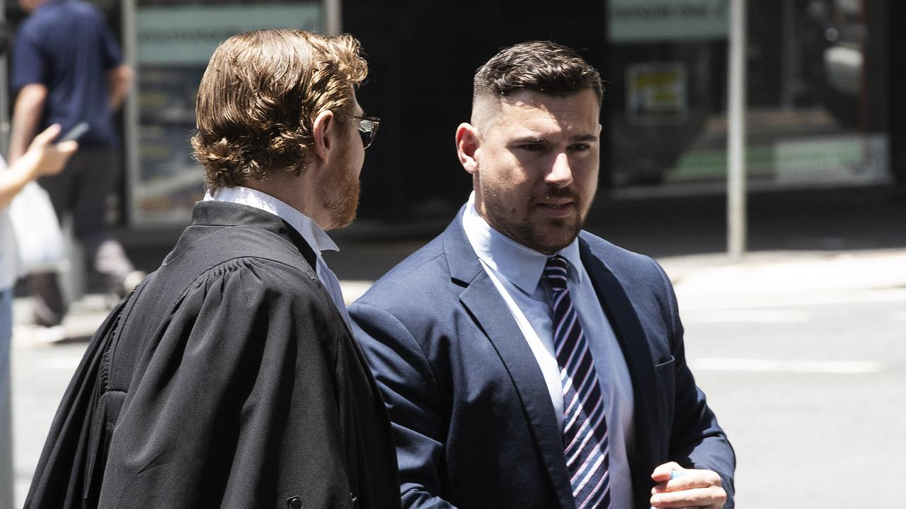 Corey Cullen (right) leaves Court. Brisbane Magistrates Court today. Picture: Attila Csaszar/AAP