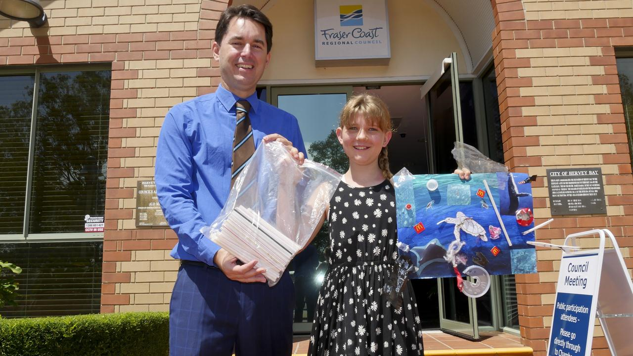 Fraser Coast Regional Council mayor George Seymour with 10-year-old Urangan girl Iluka Clifton who presented council with a proposition to get rid of single use plastic straws at council events.