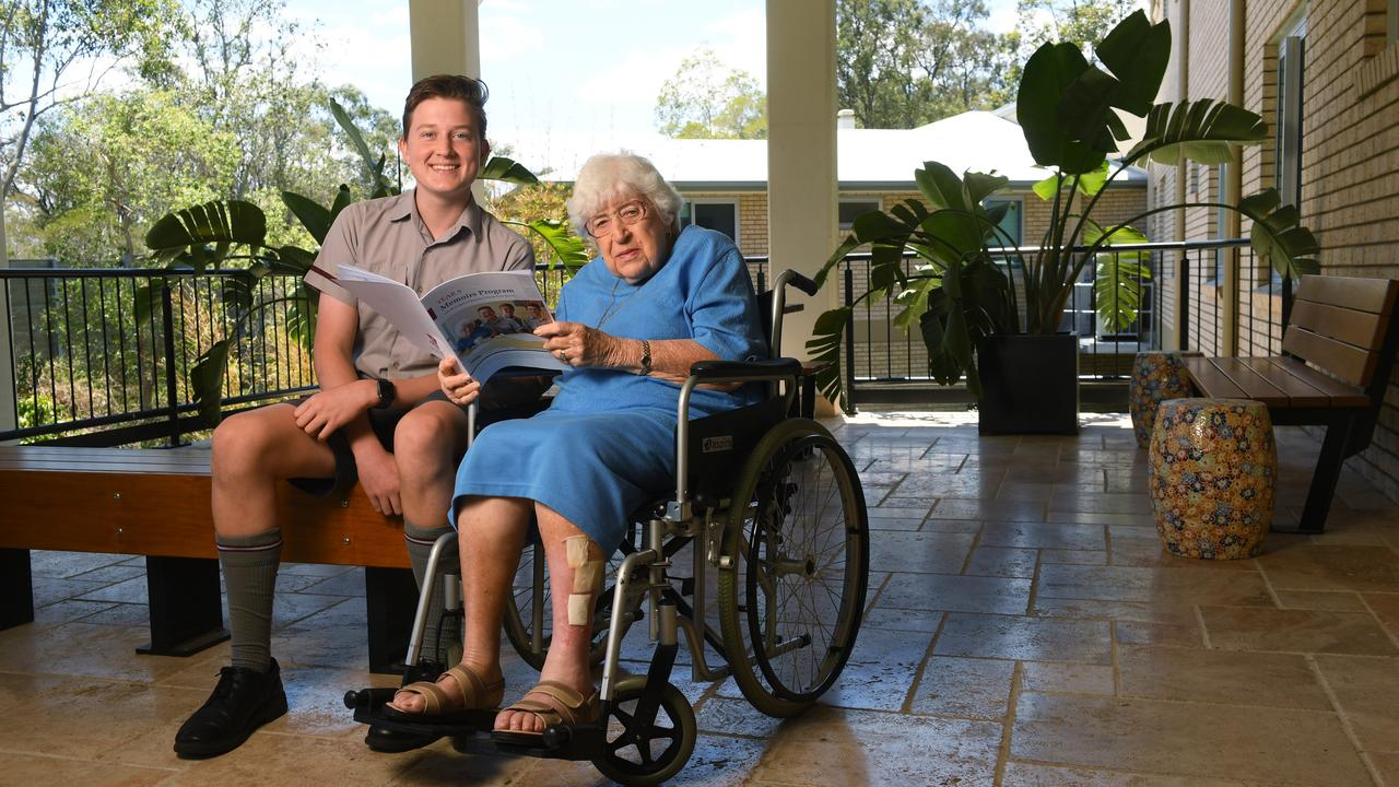 Students from Ipswich Grammar School spend time with senior citizens at Bundaleer Lodge Nursing Home and have made a book from what they have learned from talking with the residents. IGS student Mackinlay Sturges with resident Lillian Weber.