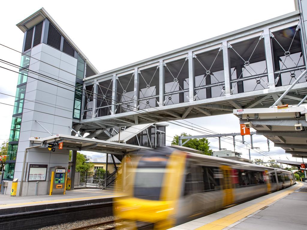 A train drives through Alderley station in Brisbane's north. Picture: AAP/Richard Walker