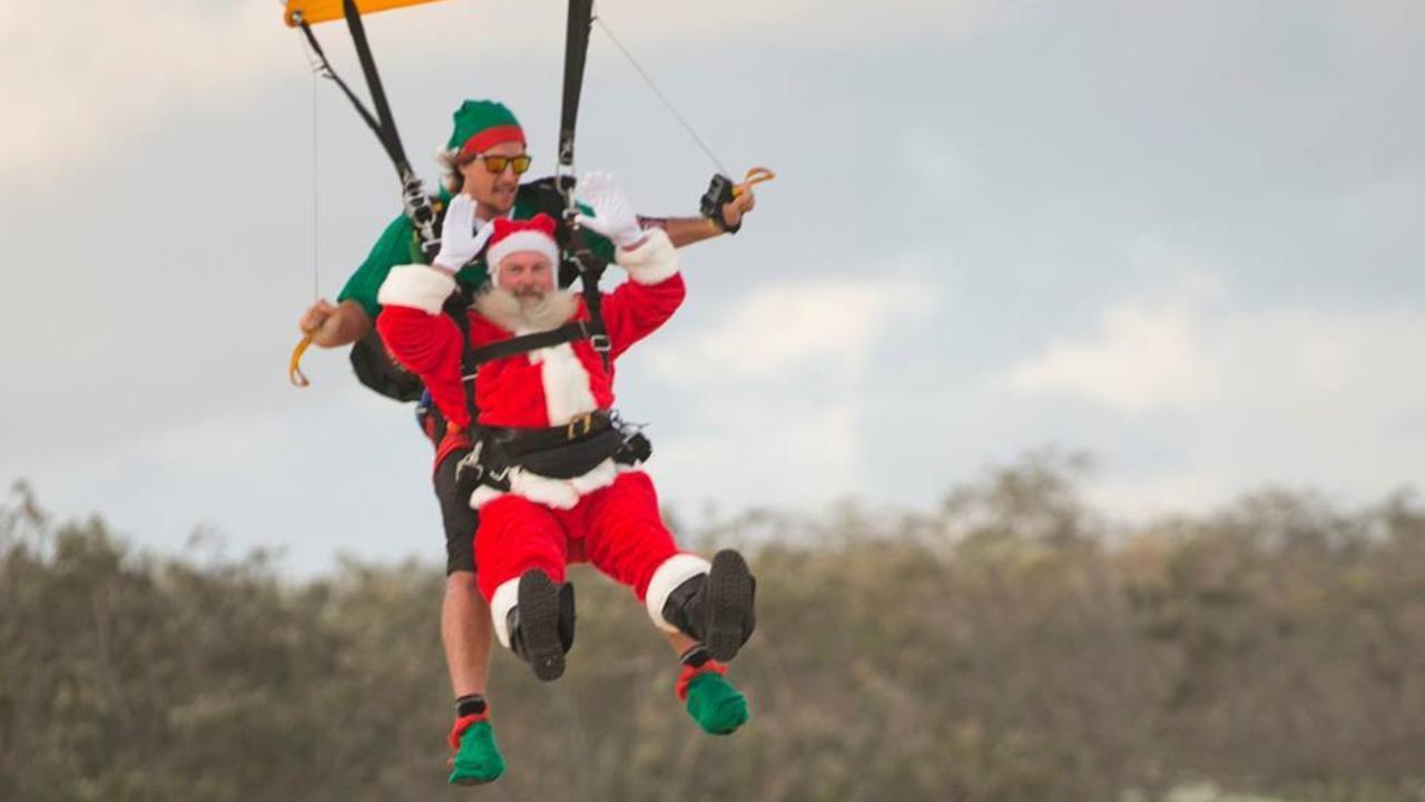 CHRISTMAS: Santa makes an impressive entrance at the 2018 carols.