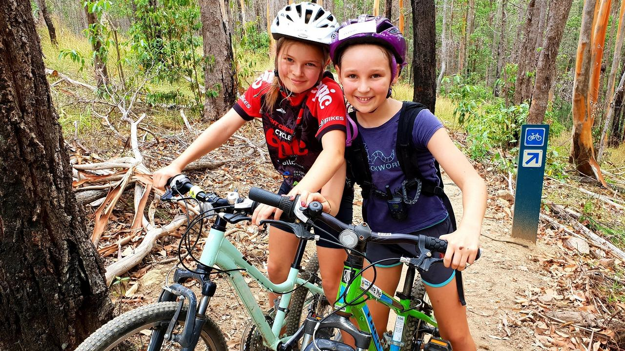 OUTDOORS: Grace Craddock and Anna Tudor at Bike On's Noosa mountain bike camps.