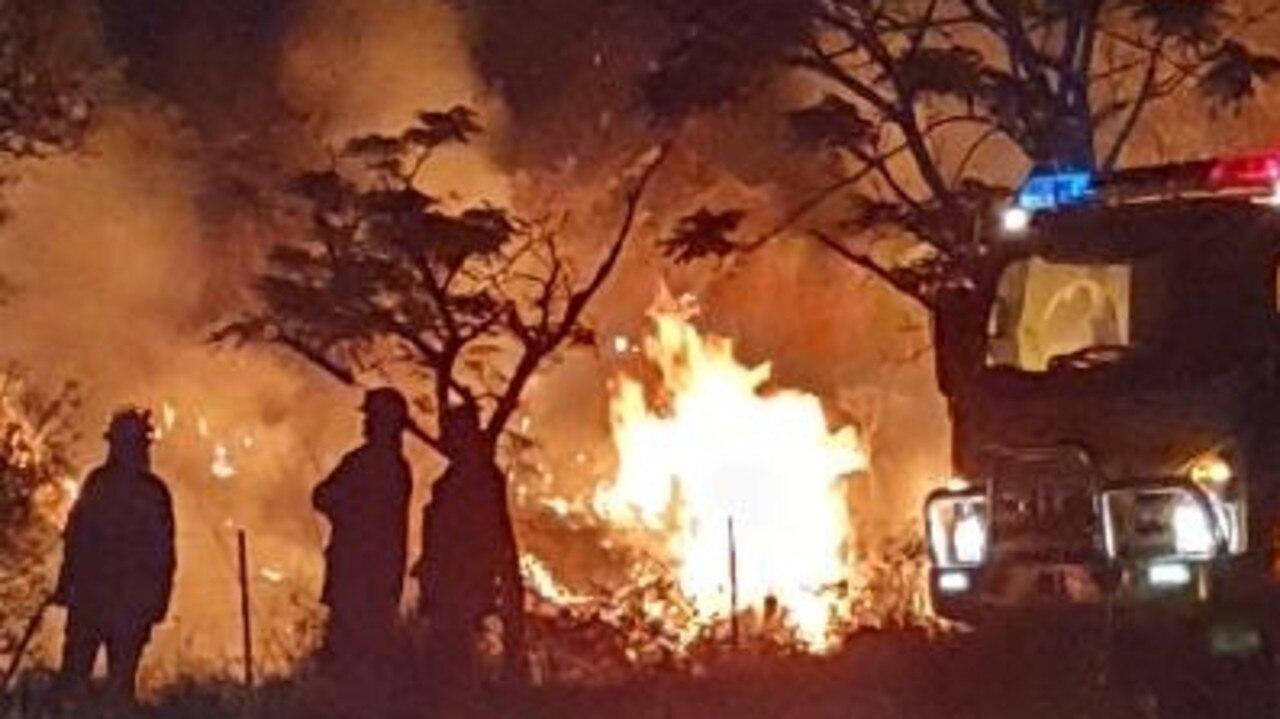 Fireys worked on backburning efforts on Wednesday night in Widgee. Photo: Col Morley