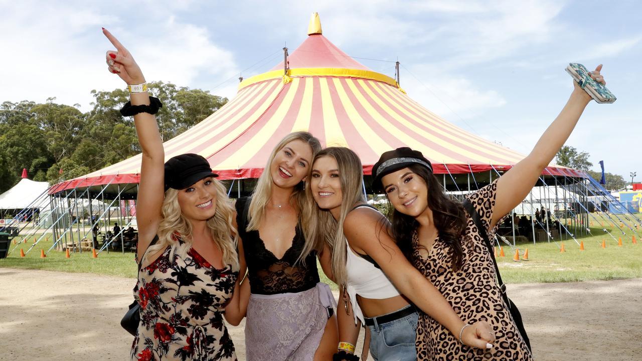 Alyse Roberts, 23, Laura Elliott, 21, Keneeka Gorter, 21 all from Tweed Coast and Bella Staracek,19, from Brisbane at the Falls Festival in North Byron Bay, Tuesday, 1 January, 2019. (AAP Image/Regi Varghese).