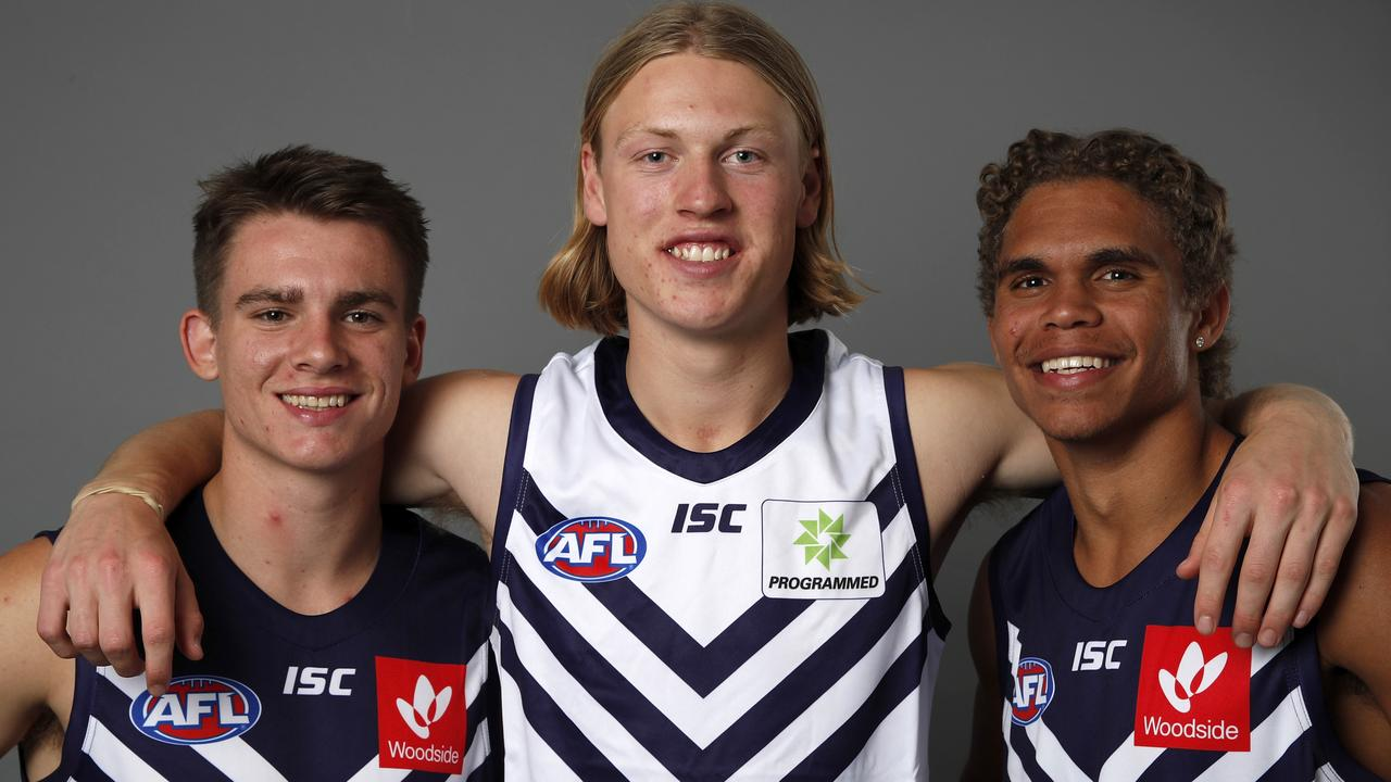 Three's company for the Dockers with new men Caleb Serong, Hayden Young and Liam Henry. Picture: AFL Photos/Getty Images